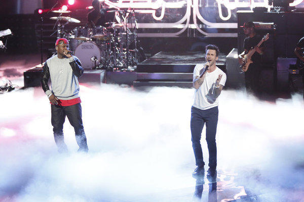 "50 Cent and Adam Levine perform on ""The Voice."""