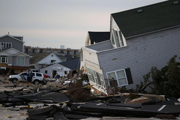 Police stand guard near beach homes that were damaged by Superstorm Sandy on November 25, 2012 in Ortley Beach, New Jersey.