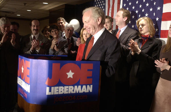 Washiongton, DC  2-3-2004 Sen. Joseph Lieberman dropped out of the presidential race today at a election night gathering of his supporters at the Hyatt hotel in Arlington, VA. Senator Lieberman waits for applause to die down after declaring he is dropping out of the race. In the background are Representatives John Larson of Ct, Eliot Engel, of NY, Rosa DeLauro, of CT, Sen. Chris Dodd, Hadassah Lieberman, Etan Tucker, Matt Lieberman, rebecca Lieberman, and Hana Lieberman. Digital photo by Richard Messina - The Hartford Courant