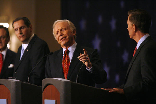 Joseph Lieberman, center, complains about the negative campaign his opponent Ned Lamont is leading during a debate with his challengers, Alan Schlesinger, left, and Lamont during the Business Council of Fairfield County event Monday in Stamford.