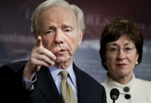 "Senator Susan Collins (R-ME) (R) listens while Senator Joseph Lieberman (I-CT) takes questions during a press conference on Capitol Hill December 9, 2010 in Washington, DC.  The US Senate was not able to get a 60 vote super majority necessary to move along a defense authorization bill that included language to repeal the US military's ""Don't Ask Don't Tell"" policy that prohibits gay service members from openly serving. The policy was eventually repealed."