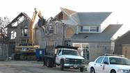 The first of several planned house demolitions began Tuesday in the Richmond Hill community.