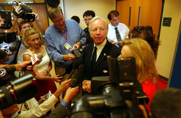 NEW HAVEN, CT - AUGUST 8:  U.S. Senator Joseph Lieberman is surrounded by the media after casting his vote at the Edgewood Elementary School August 8, 2006 in New Haven, Connecticut. Senator Lieberman lost that night in a tough race against challenger Ned Lamont for the Democratic Primary.