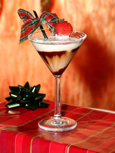 <b>Bliss</b> (Now closed)<br> <br> 1/2 oz Vanilla Vodka<br> <br> 1/2 oz Baileys<br> <br> 1/2 oz Butterscotch<br> <br> 1/2 Godiva Chocolate Liquor<br> <br> Splash Goldshlagger<br> <br> Drizzle with chocolate syrup<br> <br> Garnish with a strawberry and sugar rim