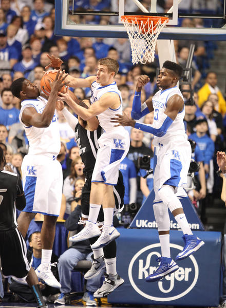 Alex Poythress, left, reacted as teammate Jarrod Polson pulled this rebound away during Friday¿s win over Long Island. Poythress says the Cats know they must get off to a better start Thursday at Notre Dame in their first true road game of the year.