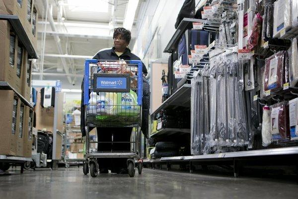 Carolyn Price pushes a shopping cart at a Wal-Mart store in Alexandria, Va.