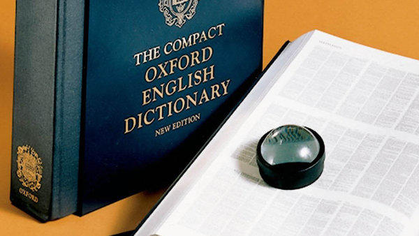 A compact edition of the Oxford English Dictionary, with print so small it comes with a magnifying glass.