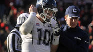 <cci:byline_name>STORRS — UConn coach Paul Pasqualoni offered no definitive word on starting quarterback Chandler Whitmer's status for Saturday's season finale against Cincinnati.</cci:byline_name>