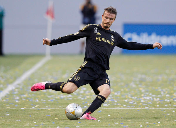 FILE - 20 NOVEMBER 2012: David Beckham has announced he will quit the American Major League Soccer team LA Galaxy in December 2012. CARSON, CA - JULY 21: David Beckham #23 of Los Angeles Galaxy kicks the ball during the MLS match against Chivas USA at The Home Depot Center on July 21, 2012 in Carson, California. The Galaxy won 3-1. (Photo by Ric Tapia/Getty Images) ORG XMIT: 75292036