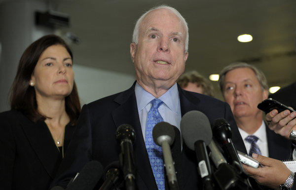 Sen. John McCain (R-Ariz.), Sen. Kelly Ayotte (R-N.H.) and Sen. Lindsey Graham (R-S.C.), speak on Capitol Hill following a meeting with U.N. Ambassador Susan Rice.