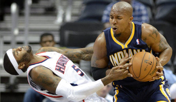 Pacers power forward David West drives against Hawks power forward Josh Smith during a game at Philips Arena in Atlanta.