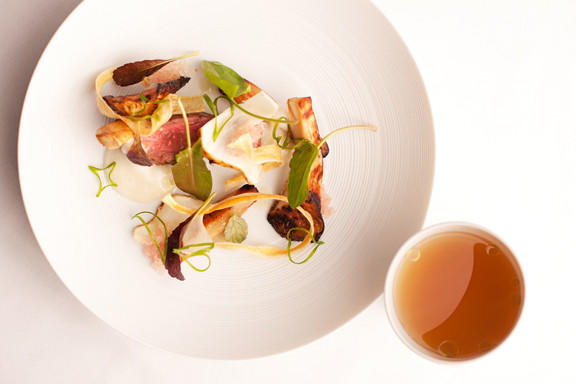 Wagyu beef ribeye with grilled matsutake mushrooms, salsify and pine-scented dashi at Grace.