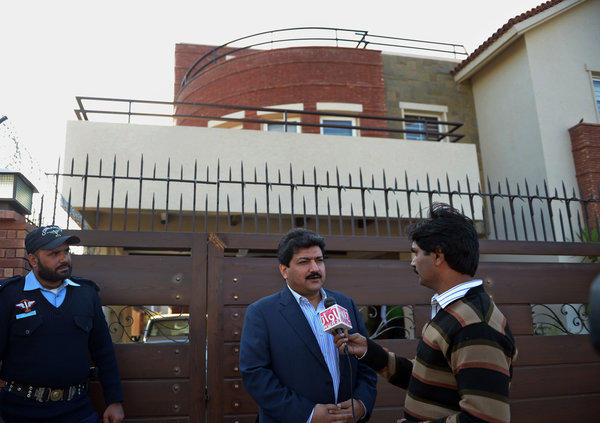 Pakistani journalist and television anchor Hamid Mir talks with media representatives outside his home in Islamabad on Monday.
