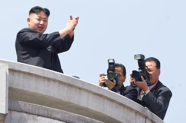 "North Korean leader Kim Jong-Un -- the Onion's ""Sexiest Man Alive"" -- attends a military parade in Pyongyang."