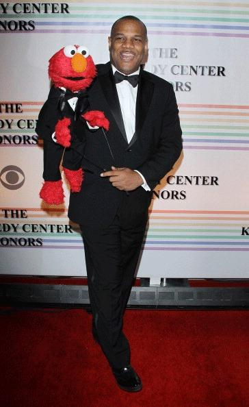 Sesame Street character Elmo and Kevin Clash pose for photographers on the red carpet at the Kennedy Center for the gala performance for the 2011 Kennedy Center Honors in Washington, December 4, 2011.