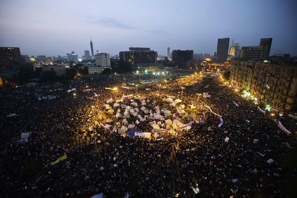 Tens of thousands people take part in a mass rally at Egypt's landmark Tahrir Square in Cairo. The demonstrators are protesting a decree by President Mohamed Morsi granting himself broad powers.