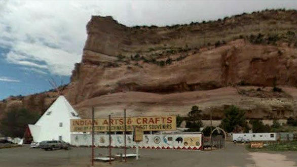 The rusty red striated grooves of the Cars Land mountain range look just like the real cliffs looming above the Teepee Trading Post in Lupton, Ariz.