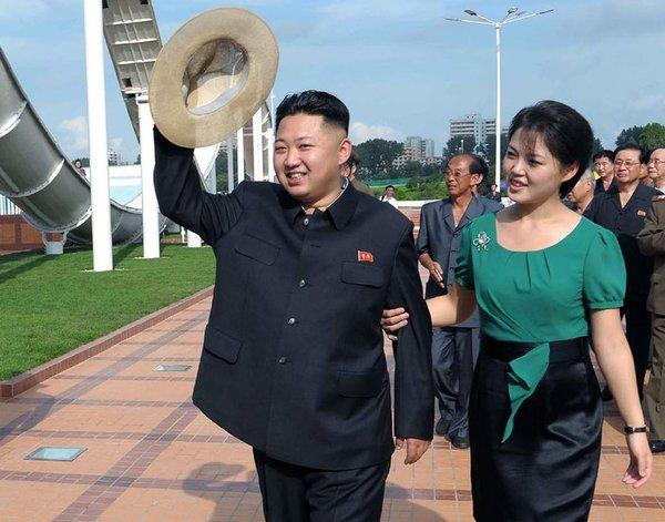 North Korean leader Kim Jong Un, with his wife, Ri Sol Ju, was called 2012's sexiest guy by the Onion. People's Daily agreed.