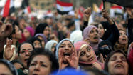 CAIRO -- Tens of thousands of Egyptians gathered in the capital and other major cities across the nation Tuesday demanding that Islamist President Mohamed Morsi rescind a self-issued constitutional decree that gives him sweeping powers.