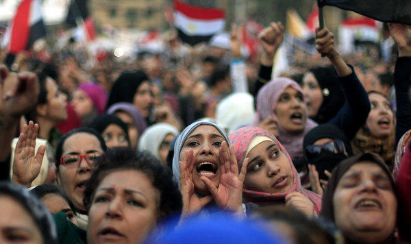 Egyptian protesters chant slogans against President Mohamed Morsi in Tahrir Square in Cairo.