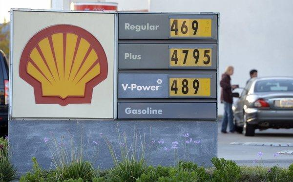 Motorists fill up at a Shell station in Pacific Palisades last month in the week in which the state's average price for a gallon of regular gasoline reached a record of $4.671. West Coast senators are calling for a federal investigation of the region's refineries.