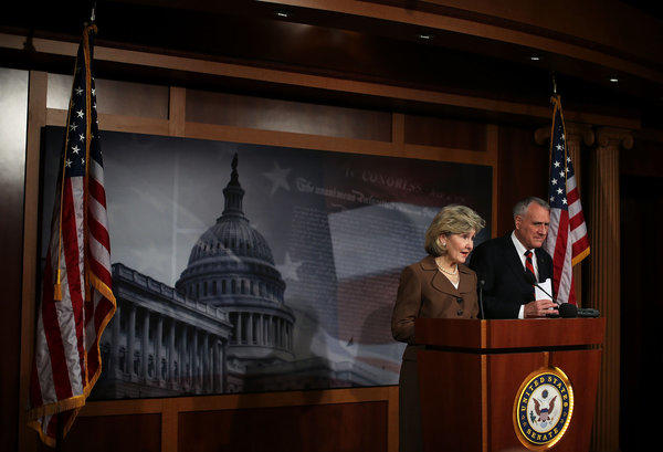 Sen. Kay Bailey Hutchison (R-Texas) speaks as Sen. Jon Kyl (R-Ariz.) listens during a news conference on Capitol Hill.