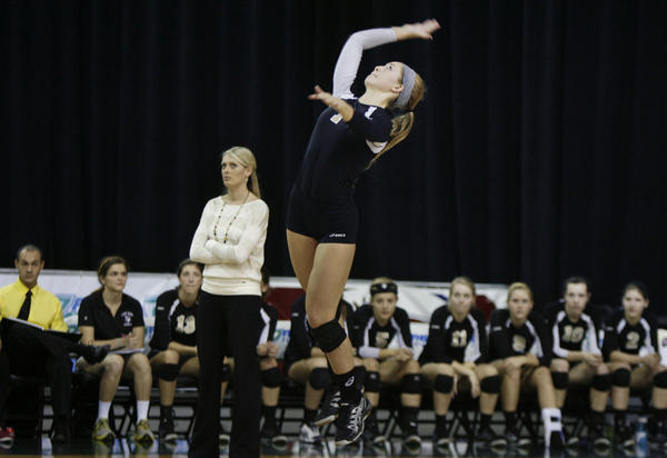 Bishop Moore's Allie Monserez serves during the FHSAA Class 4A state championship game of Bishop Moore versus Berkeley Prep at the Silver Spurs Arena in Kissimmee on Saturday, November 17, 2012. Bishop Moore won the game 3 sets to 0 to claim the 4A state championship title.