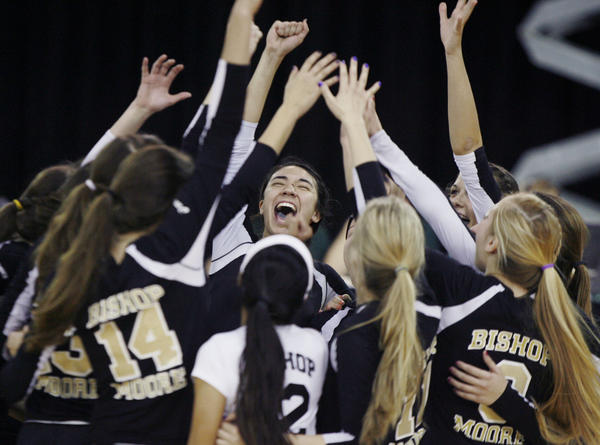 Bishop Moore players celebrate during the FHSAA Class 4A state championship game of Bishop Moore versus Berkeley Prep at the Silver Spurs Arena in Kissimmee on Saturday, November 17, 2012. Bishop Moore won the game 3 sets to 0 to claim the 4A state championship title.