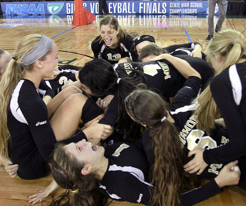 Bishop Moore players celebrate after winning the FHSAA Class 4A state championship game of Bishop Moore versus Berkeley Prep at the Silver Spurs Arena in Kissimmee on Saturday, November 17, 2012. Bishop Moore won the game 3 sets to 0 to claim the 4A state championship title