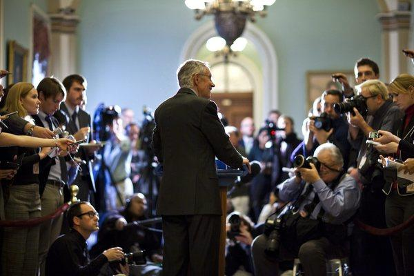 "In the Capitol, Democratic Senate Majority Leader Harry Reid speaks to the media about the impending ""fiscal cliff."""
