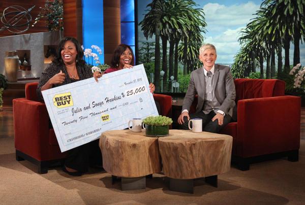 Julia and Sonya Hawkins accept a check during The Ellen DeGeneres Show.
