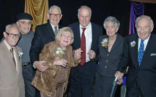 Event Chairman Nat Rubinfeld, fifth from left, is flanked by honorees, from left, Ray Marks, Barney Meskin, Jerry Moss, Lois Bennett, Pearl Lipner and Sonny Siegel.