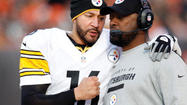 PITTSBURGH (AP) — Ben Roethlisberger took a break from changing his newborn son's diapers to throw a few passes with his sprained right shoulder on Monday.
