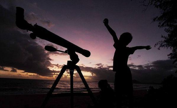 A young boy gets ready to view the solar eclipse with his telescope Nov. 14 in Palm Cove, Australia. Wednesday's penumbral lunar eclipse will be less dramatic.