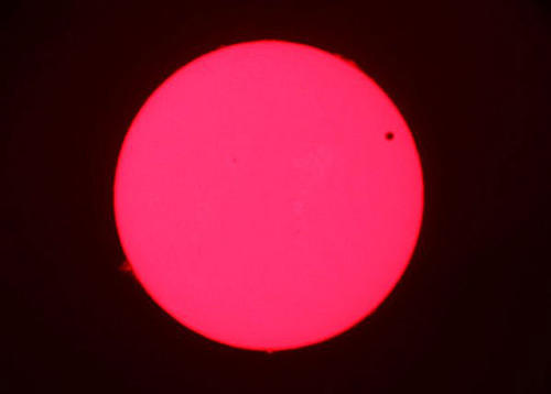 The planet Venus passes in front of the sun as seen through a telescope on Mt. Wilson in June 2012.