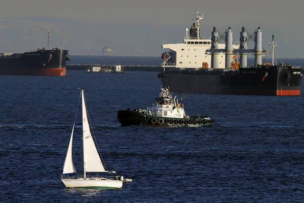 The Organization for Economic Cooperation and Development forecasts the gross domestic product across its 34 member nations to grow a sluggish 1.4% next year. Above, oil tankers off Long Beach.