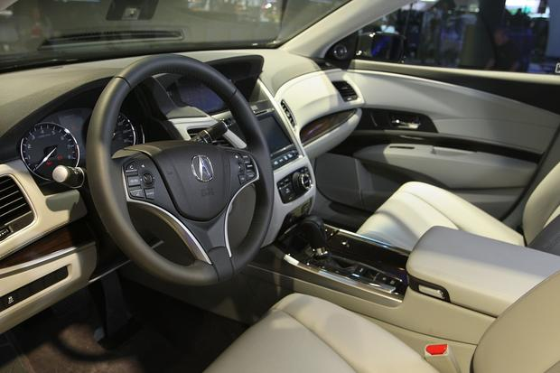 The interior of the RLX. Acura's flagship sedan will offer safety features such as lane departure warning, forward collision warning and automatic braking.