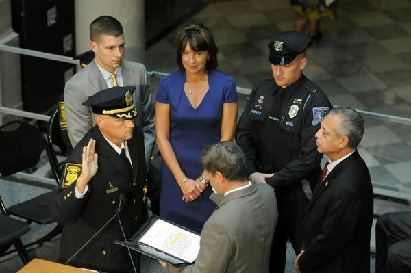 James C. Rovella is formally sworn in as Hartford police chief on Sept. 26. Witnessing the event are from left, son Marc Rovella, his wife, Sandy Rovella, son Daniel Rovella, a Willimantic officer, and Hartford Mayor Pedro Segarra. Hartford Town Clerk John Bazzano swears in Rovella.
