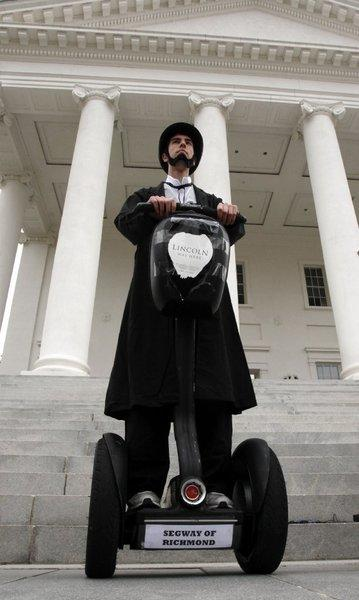 "You can walk in Lincoln's footsteps--or, in this case, roll in them--on a new tour in Richmond, Va., where much of the movie ""Lincoln"" was shot. Christopher Brady, dressed as Abraham Lincoln, kicked off the launch this month of the Segway tour, one of several that are now available in Richmond area."