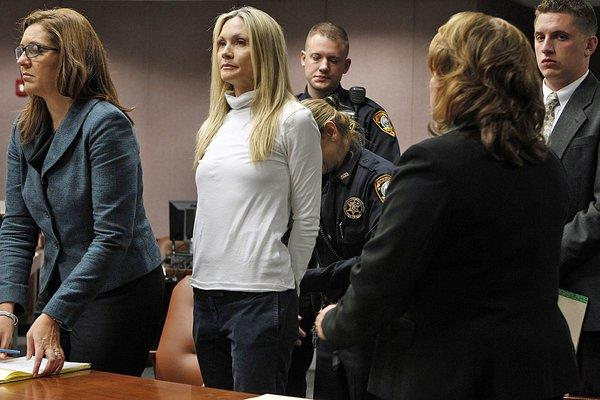 "Former ""Melrose Place"" actress Amy Locane-Bovenizer, 40, is taken into custody after jurors in Somerville, N.J., convicted her of vehicular homicide. At left is her attorney Ellen Torregrossa-O'Connor."