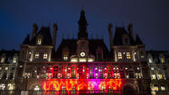 A picture taken on December 1, 2010 shows an AIDS logo set on the front of Paris City Hall during a light show marking World AIDS Day.