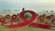 This is an AIDS-awareness sand sculpture created by artist Sudarshan Pattnaik ahead of World Aids Day at Golden Sea beach in Puri, about 65 kilometers from the eastern city Bhubaneswar on November 30, 2009.
