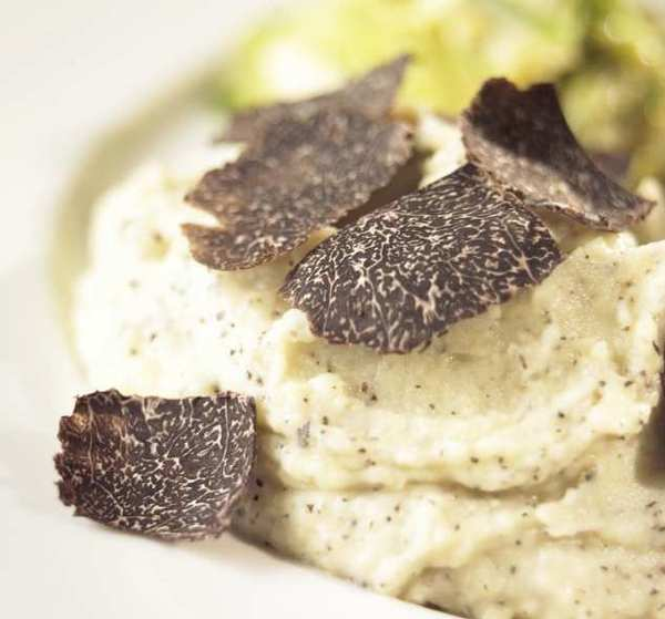 Luxurious mashed potatoes are flavored with fresh black truffle.