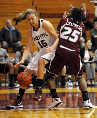 Lafayette's Emily Homan (left) dribbles past Rider's Sironda Chambers(right) during the first half of their basketball game Tuesday night.