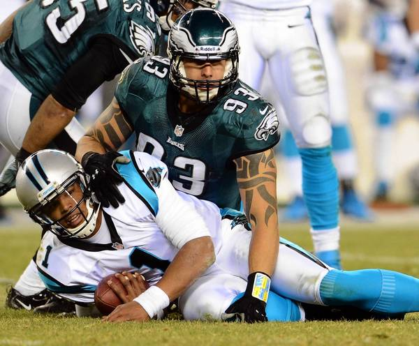 Jason Babin (93) stops Carolina Panthers quarterback Cam Newton (1) at Lincoln Financial Field in Philadelphia on Monday. The team announced on Tuesday that Babin has been released.