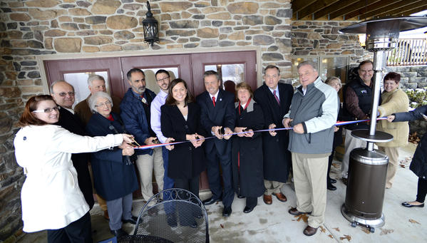 Wine experts, local officials and family members joined Kevin and Yvonne Ford on Tuesday to officially open their Red Heifer Winery on Raven Rock Road near Smithsburg.