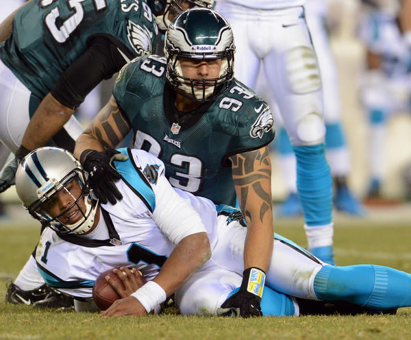 Philadelphia Eagles defensive end Jason Babin (93) stops Carolina Panthers quarterback Cam Newton (1) at Lincoln Financial Field in Philadelphia on Monday.
