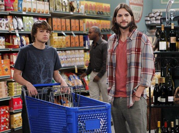 Angus T. Jones, left, as Jake and Ashton Kutcher as Walden in a scene from 'Two and a Half Men.""