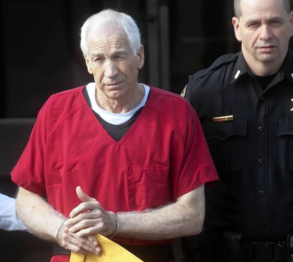 Jerry Sandusky leaves the Centre County Courthouse in Bellefonte after being given a 30-60 year sentence on Tuesday October 9, 2012.