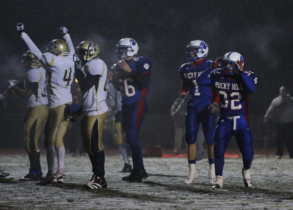 Rocky Hill's Greg Marzilli (32) reacts after missing a game-tying extra point against Hyde. The kick was deflected by the Wolves' defense.